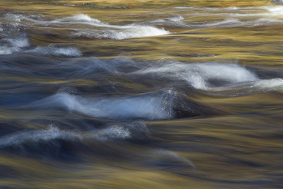 Autumn reflected in fast water