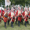 Both British regulars and Loyalists marching in unison against  the French