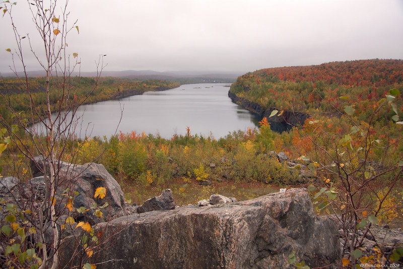 A broad vista of Benson Mines looking south from atop the tailings at the northern terminus. The ore processing areas are at the opposite end of the pit, now lake.