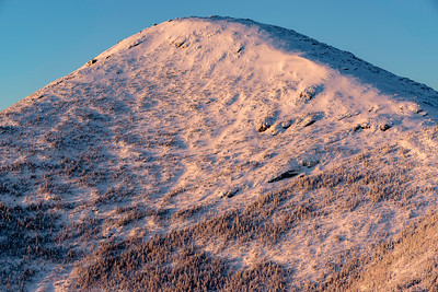 Morning sun casting onto summit of Algonquin Peak