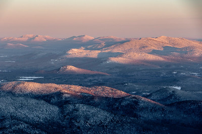 Sun rising over the Adirondack Mountains