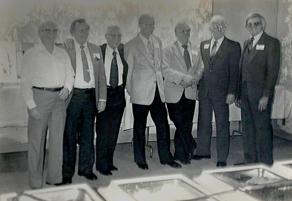 """<p align=""""left""""><h3>25th Anniversary Dinner</h3></p> <p align=""""justify"""">L to R: Gordon Maxcy, Bob Dial, Bill Razey, Langston McEachern, Jack Barham, T.C. Smith and Tom Drummond.  The group was present to participate in celebration of the 25th Year Anniversary.  All but Langston and Jack were founding or early SPS members.</p> <p align=""""justify""""> The picture was taken by Jim Nelson of Atlanta, Georgia, owner of  The Nelson Touch Studio on Cheshirebridge Road, who drove here from Atlanta with Diana Wallace to attend the meeting.  Both Jim and Diana were current or former partners of Bob's in studios of Atlanta.</p> <p align=""""justify"""">Jack and Langston were chief photographers of  Shreveport's Journal and Times, respectively.  Bob served under Jack in the Marines and Langston was Bob's boss at the newspaper for 8 ½ years in the '50s and '60s. </p>  <p align=""""left""""><h5><u><i>Photo courtesy of Bob Dial</i></u></h5></p>  <br />"""