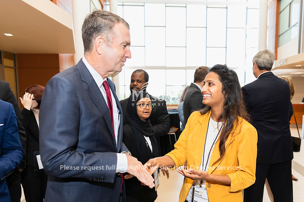Governor Ralph Northam talks with Goerge Mason University senior Dolica Gopisety before an Amazon Web Services cloud computing degree launch event. Photo by Lathan Goumas/Office of Communications and Marketing   Photo Taken:Friday, September 20, 2019