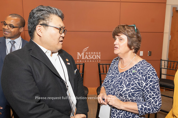 Andrew Ko of Amazon Web Services talks with George Mason University President Anne Hilton at an AWS cloud computing degree launch event. Photo by Lathan Goumas/Office of Communications and Marketing   Photo Taken:Friday, September 20, 2019