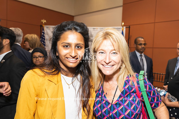 George Mason University senior Dolica Gopisetty talks with George Mason University Vice President for Academic Innovation and New Ventures Michelle Marks at an AWS cloud computing degree launch event. Photo by Lathan Goumas/Office of Communications and Marketing   Photo Taken:Friday, September 20, 2019