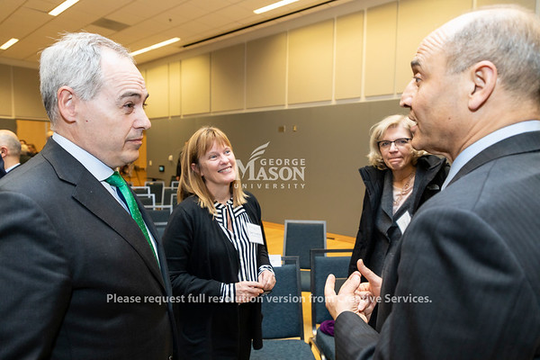 Ángel Cabrera, George Mason University President, and Deb Crawford, Vice President for Research, talk with Victor Hoskins, Arlington Economic Development Director, following a discussion about Amazon held by the Metropolitan Washington Council of Governments at George Mason University. Photo by Lathan Goumas/Strategic Communications