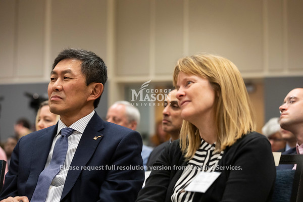 S. David Wu, George Mason University Provost, and Deb Crawford, Vice President for Research, listen during a panel discussion about Amazon's selection of Arlington for a second headquarters held by the Metropolitan Washington Council of Governments hosted by George Mason. Photo by Lathan Goumas/Strategic Communications