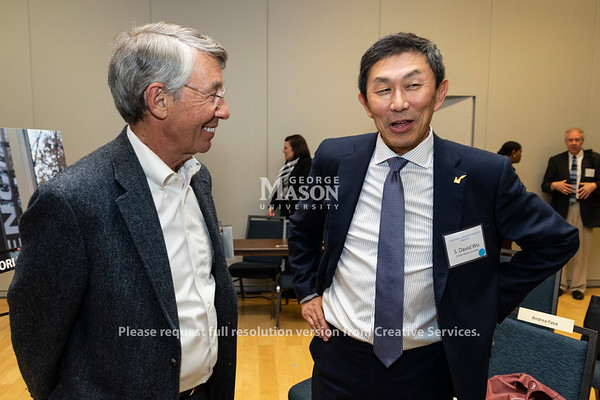 Stephen Fuller, Dwight C. Schar Endowed Faculty Chair, talks with S. David Wu, George Mason University Provost, following a discussion about Amazon held by the Metropolitan Washington Council of Governments at George Mason University. Photo by Lathan Goumas/Strategic Communications