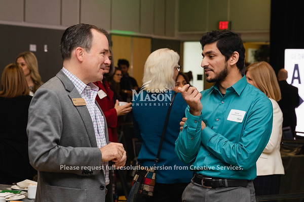 George Mason University Visitor Juan Carlos Iturregui talks with student Afnan Ali during the Arlington Forward celebration. Photo by Lathan Goumas/Office of Communications and Marketing   Photo Taken:Wednesday, November 20, 2019