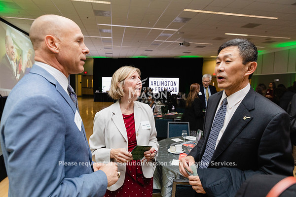 George Mason University Director of Athletics Brad Edwards, Senior Vice President for Finance and Administration Carol Kissal and Provost S. Daivd Wu talk during the Arlington Forward celebration. Photo by Lathan Goumas/Office of Communications and Marketing   Photo Taken:Wednesday, November 20, 2019