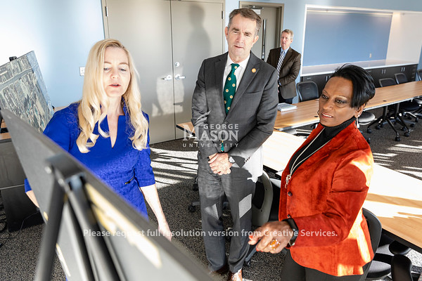 Governor Ralph Northam listens as Volgenau School of Engineering Associate Dean for Strategic Initiatives and Community Engagement Liza Wilson Durant and chef of staff Deitra Trent  talk about the proposed expansion of the Arlington Campus at George Mason University. Photo by Lathan Goumas/Office of Communications and Marketing   Photo Taken:Friday, October 18, 2019