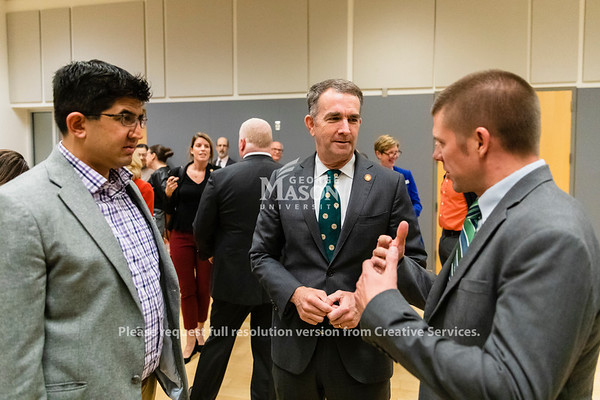 Governor Ralph Northam talks with Patrick Vora and Chris Boies after announcing a plan for state agencies and institutions to get 30 percent of their power from renewable sources by 2022 during an event at George Mason University's Arlington Campus. Photo by Lathan Goumas/Office of Communications and Marketing   Photo Taken:Friday, October 18, 2019