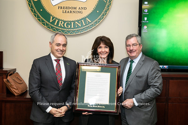 Vice President, Univ Adv and Alumni Rel/President GMUF Inc, Office of University Advancement and Alumni Relations Janet Bingham, center, receives the Commendation Appreciation award from the Board of Visitors. President Ángel Cabrera at left and Board of Visitors Vice Rector  James W. Hazel, right. Photo by:  Ron Aira/Creative Services/George Mason University