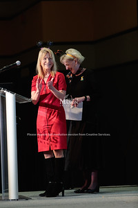 Vice President for Academic Innovation and New Ventures Michelle Marks applauds Director of Presidential Administration Sharon Cullen during the 2019 Outstanding Achievement Awards. Photo by Ian Shiff/Creative Services/George Mason University