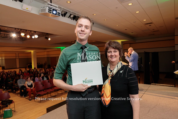 Cody Clarke receives an Exceptional Support Award from Interim President Anne Holton at the 2019 Outstanding Achievement Awards. Photo by Ian Shiff/Creative Services/George Mason University