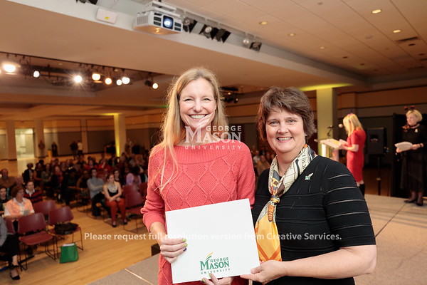 Christy Hogan receives an Outstanding Achievement Award from Interim President Anne Holton during the 2019 Outstanding Achievement Awards. Photo by Ian Shiff/Creative Services/George Mason University