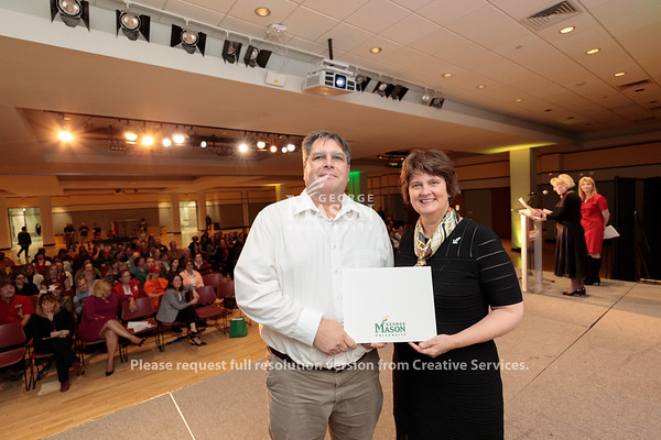 Tom Reinsel receives an Outstanding Achievement Award from Interim President Anne Holton during the 2019 Outstanding Achievement Awards. Photo by Ian Shiff/Creative Services/George Mason University