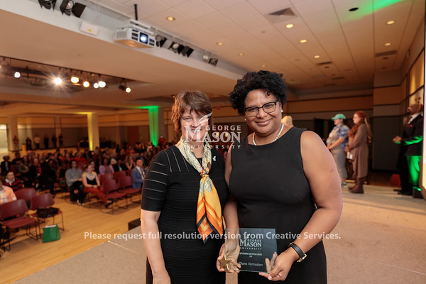 Interim President Anne Holton presents Diane Vermaaten receives with an Outstanding Supervisor Award during the 2019 Outstanding Achievement Awards. Photo by Ian Shiff/Creative Services/George Mason University