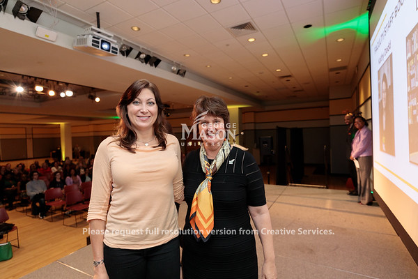 Laura Todd receives a Faculty Staff Book Scholarship from Interim President Anne Holton during the 2019 Outstanding Achievement Awards. Photo by Ian Shiff/Creative Services/George Mason University