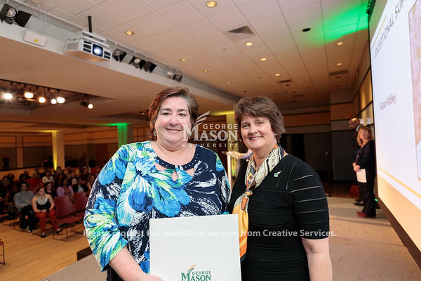 Susan Ridley receives an Exceptional Support Award from Interim President Anne Holton during the 2019 Outstanding Achievement Awards. Photo by Ian Shiff/Creative Services/George Mason University