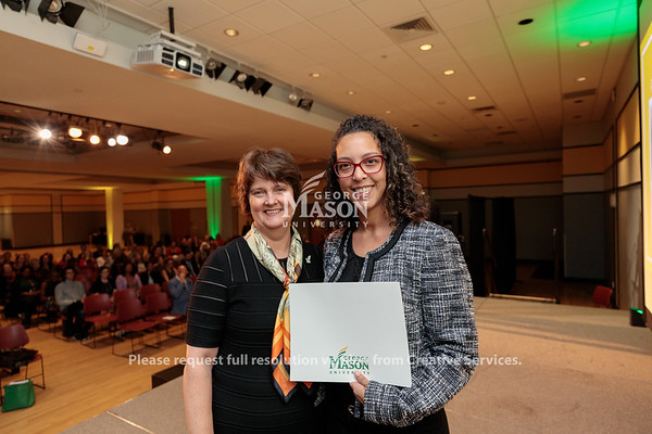 Interim President Anne Holton presents a Civility Star Award to Trasi Watson during the 2019 Outstanding Achievement Awards. Photo by Ian Shiff/Creative Services/George Mason University