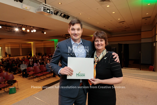Ryan Barnett receives the Civility Star Award from Interim President Anne Holton during the 2019 Outstanding Achievement Awards. Photo by Ian Shiff/Creative Services/George Mason University