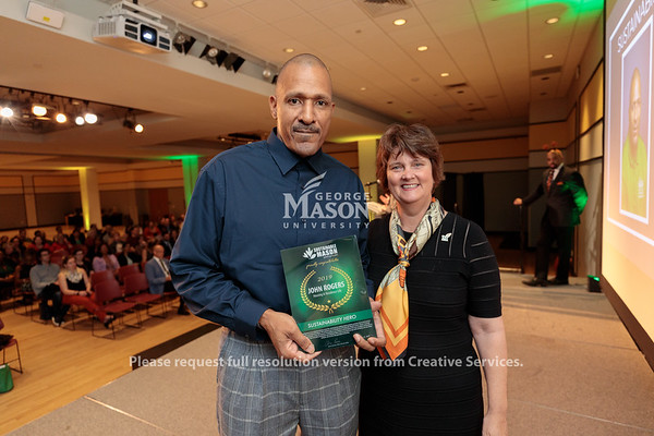 John Rogers receives the Sustainability Hero Award from Interim President Anne Holton during the 2019 Outstanding Achievement Awards. Photo by Ian Shiff/Creative Services/George Mason University