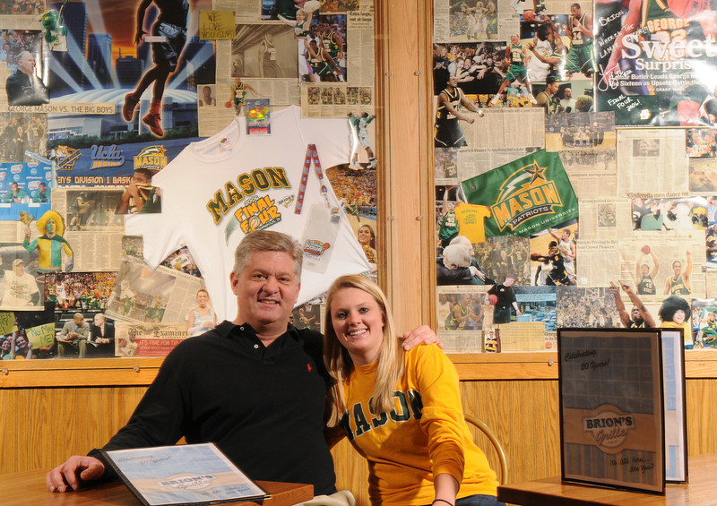 Brion Sumser and daughter Maddie Sumser posing in Brion's Grille.