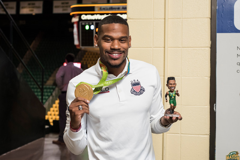 Mason alumnus and Olympic gold medalist David Verburg is honored with a bobble head and trading card during the men's basketball game against La Salle on Sat. Feb. 4, 2016.  Photo by Bethany Camp/Creative Services/George Mason University