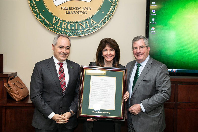 Vice President, Univ Adv and Alumni Rel/President GMUF Inc, Office of University Advancement and Alumni Relations<br /> Janet Bingham, center, receives the Commendation Appreciation award from the Board of Visitors. President Ángel Cabrera at left and Board of Visitors Vice Rector  James W. Hazel, right. Photo by:  Ron Aira/Creative Services/George Mason University