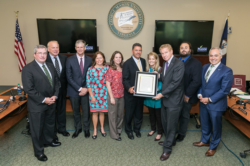 (L to R) Visitor James W. Hazel; Group President, Land Acquisition Planning Development Van Metre Companies; Ken Ryan, Partner, Van Metre Companies; Betsy Ryan; Julie van der Vate, CFO, Van Metre Companies; Rick Rabil, CEO, Van Metre  Companies; Alison Van Metre Paley; Rector Tom Davis; Sam Paley; President Ángel Cabrera.<br /> BOV meeting October 10, 2018.  Photo by:  Ron Aira/Creative Services/George Mason University
