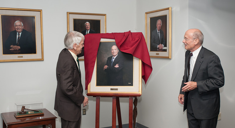 Alan Merten unveils a portrait of Rector Ernst Volgenau at a Board of Visitors meeting at Fairfax Campus. Photo by Alexis Glenn/Creative Services/George Mason University