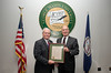 Chief of Staff Tom Hennessey accepts a plaque from Rector Ernst Volgenau at a BOV meeting at Fairfax Campus. Photo by Alexis Glenn/Creative Services/George Mason University