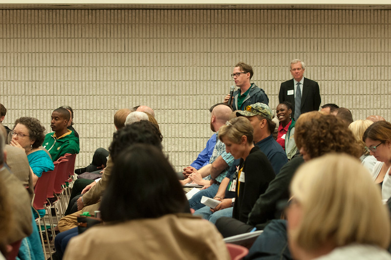 Community members ask questions during the discussion at the Fairfax West Campus Vision Workshop.  Photo by Bethany Camp/Creative Services/George Mason University