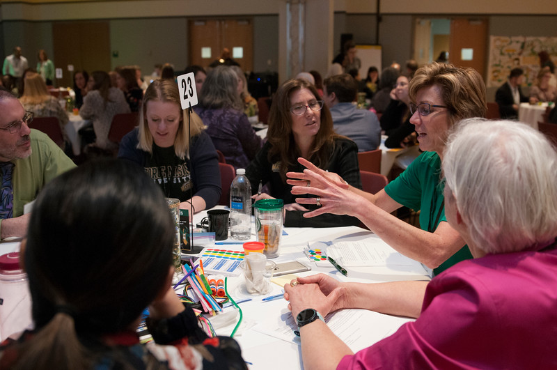 Mason faculty, students, and community members come together at the Diversity and Well-Being Summit to discuss strategies for an ideal future . (Bethany Camp/Creative Services/George Mason University)