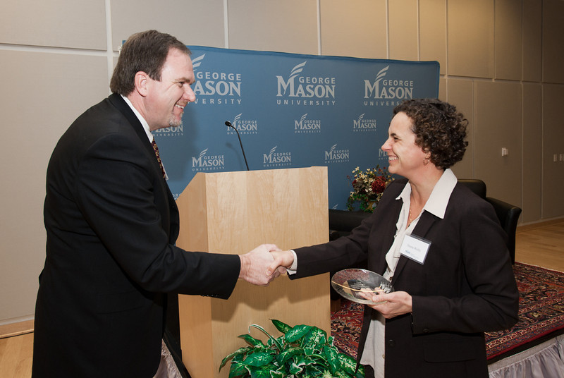 Dr. Paul Rogers, of the Mason Center for Social Entrepreneurship, presents an award for Social Innovation Champions to Diana Wells, of Ashoka, at the Mason Center for Social Entrepreneurship's Accelerating Social Entrepreneurship conference at George Mason University's Arlington Campus.