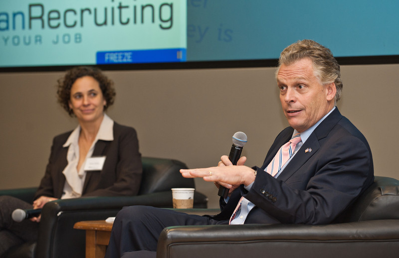 (L for R) Diana Wells, of Ashoka, and Terry McAuliffe, of GreenTech Automotive, speak at the Mason Center for Social Entrepreneurship's Accelerating Social Entrepreneurship conference at George Mason University's Arlington Campus.