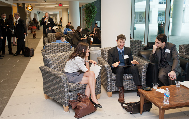 Attendees of the Mason Center for Social Entrepreneurship's Accelerating Social Entrepreneurship conference socialize at George Mason University's Arlington Campus.