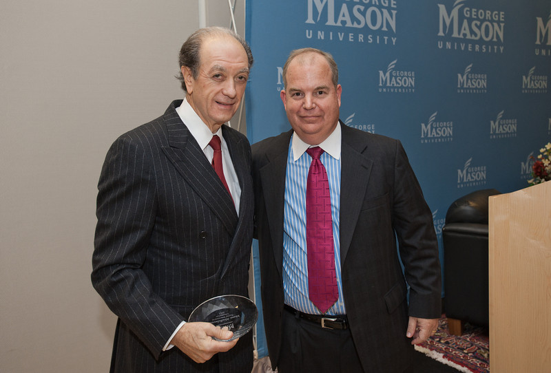 Tim Meyers, of the George Mason University Foundation, presents an award for Social Innovation Champions to Mario Morino of Venture Philanthropy Partners, at the Mason Center for Social Entrepreneurship's Accelerating Social Entrepreneurship conference at George Mason University's Arlington Campus.