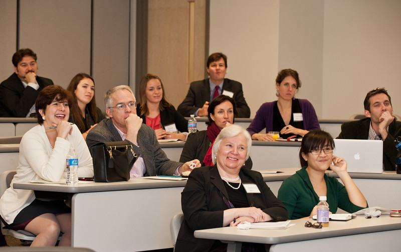 Attendees of the Mason Center for Social Entrepreneurship's Accelerating Social Entrepreneurship conference listen to speakers at George Mason University's Arlington Campus.