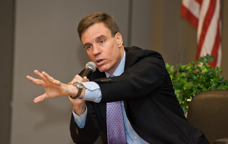 Virginia Senator Mark Warner speaks at the Mason Center for Social Entrepreneurship's Accelerating Social Entrepreneurship conference at George Mason University's Arlington Campus.