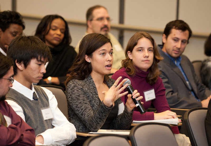 An attendee of the Mason Center for Social Entrepreneurship's Accelerating Social Entrepreneurship conference asks a question at George Mason University's Arlington Campus.