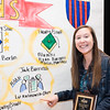 Jade Barricelli Spirit of Advising Excellence Award winner Elizabeth Kalinowski Ohrt, Director, Advising, Undergraduate Academic Affairs, College of Humanities and Social Sciences, poses stands next to some artwork about her award at the 2016 Outstanding Achievement Awards.  Photo by Ron Aira/Creative Services/George Mason University