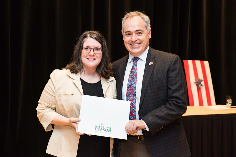 President Ángel Cabrera poses with Nancy Murphy Mason Spirit Award winner Amy Snyder, Director, Special Projects, University Life, during the 2016 Outstanding Achievement Awards.  Photo by Ron Aira/Creative Services/George Mason University