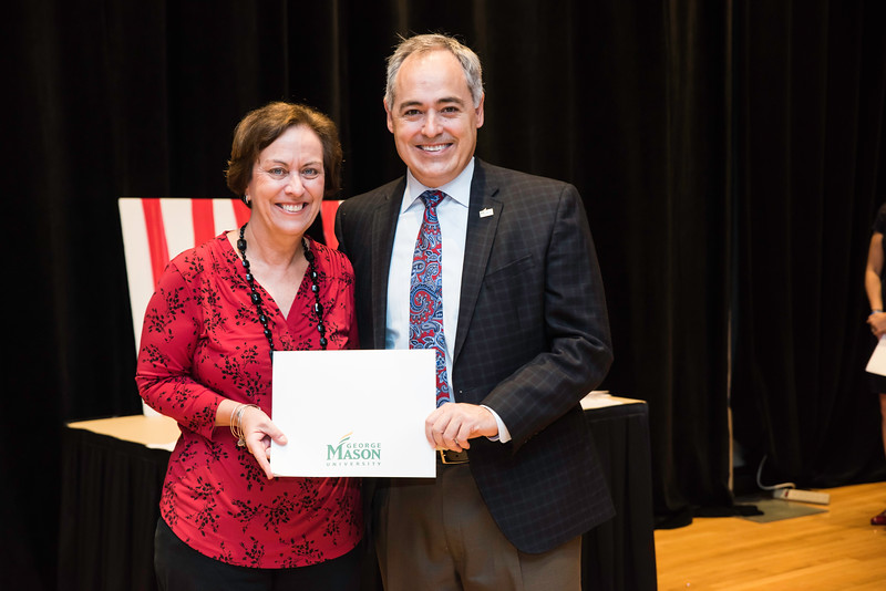 Julie Roberts with President Ángel Cabrera at the 2016 Outstanding Achievement Awards.  Photo by:  Ron Aira/Creative Services/George Mason University