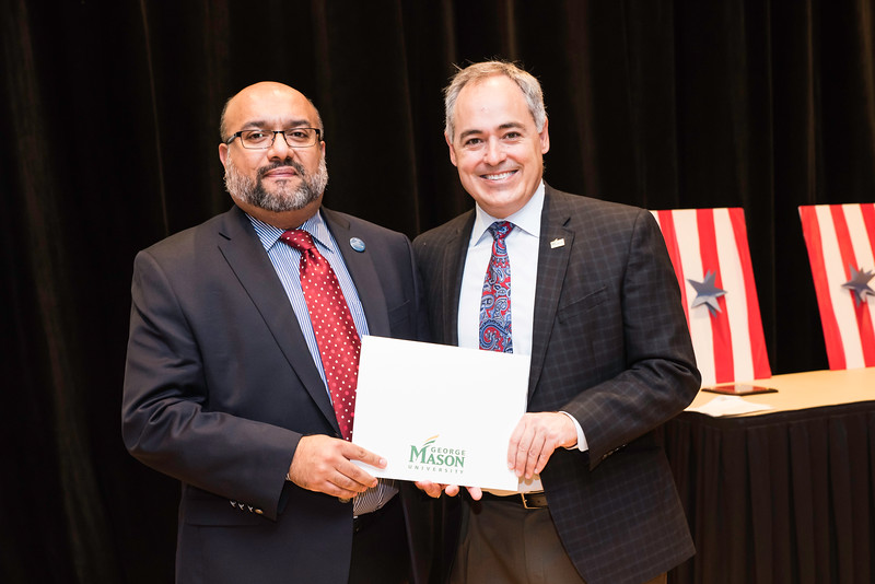Marcos Martinez with President Ángel Cabrera at the 2016 Outstanding Achievement Awards.  Photo by:  Ron Aira/Creative Services/George Mason University