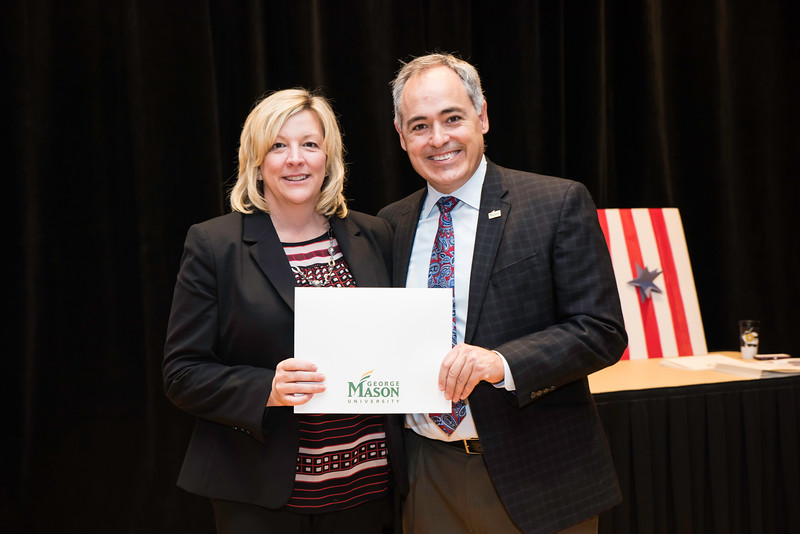 Debbie Brady with President Ángel Cabrera at the 2016 Outstanding Achievement Awards.  Photo by:  Ron Aira/Creative Services/George Mason University
