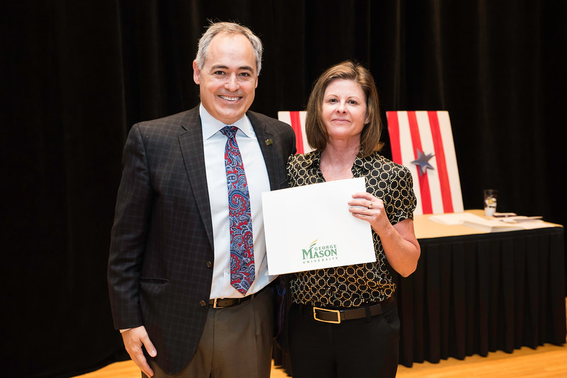 Lisa Nolder with President Ángel Cabrera at the 2016 Outstanding Achievement Awards.  Photo by:  Ron Aira/Creative Services/George Mason University