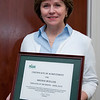 Brenda Mueller, Director, OTS, College of Education & Human Development, is presented with the employee of the month award on March 27, 2012 at Mason Hall, George Mason University.