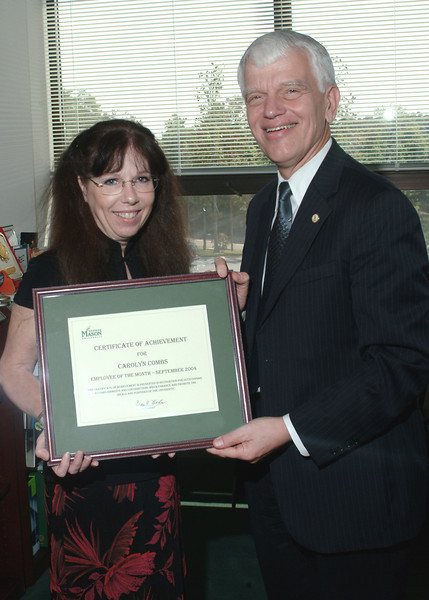 Carolyn Combs - Employee of the Month - September 2004 - with President Alan Merten